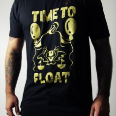 Black Short Sleeved Time To Float T-Shirt showing Pennywise the Dancing Clown from Stephen King's IT